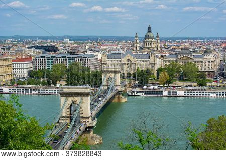 Chain Bridge Over Danube River And St. Stephen's Basilica, Budapest, Hungary