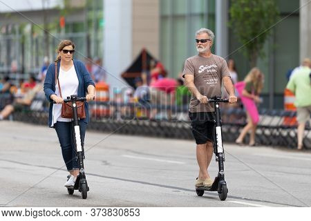 Indianapolis, Indiana, Usa - May 25, 2019: A Couple Riding Scooters From The Rental Company Bird, Do