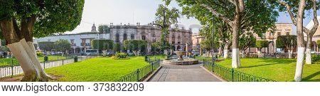 Morelia, Michoacan, Mexico - November 24, 2019: View Of The Plaza De Armas, With A Fountain And The