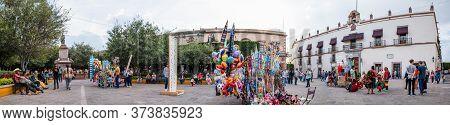Santiago De Queretaro, Queretaro, Mexico - November 24, 2019: People Enjoying The Day Among Street V