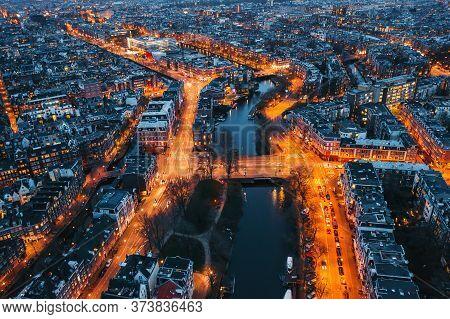 Amsterdam City Skyline At Night, Aerial View, Amsterdam, Netherlands, Drone Photo.