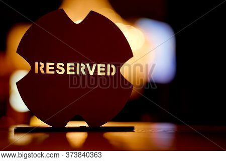 Red Wooden Plate Reserved On The Table. Label, Cafe.