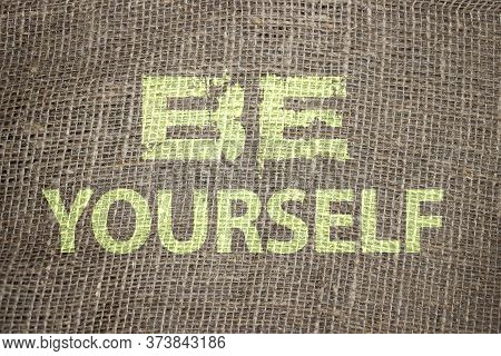 Be Yourself Text On Brown Burlap. Retro Burlap Background Vintage Country Rustic Style. Motivation B