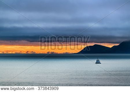 Scenery Of A Small Ship On The Bering Sea And The St Lawrence Island In The Background At Dusk On A