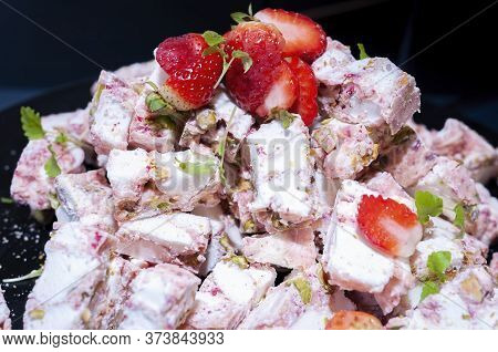 Freshly Cut Strawberries On Top Of A Stack Of Chunky Candy Nougat. Self-service Food Items As Cateri