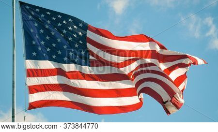 Flag Of The United States Of American Blowing In The Wind. Closeup Of Large American Flag Waving In