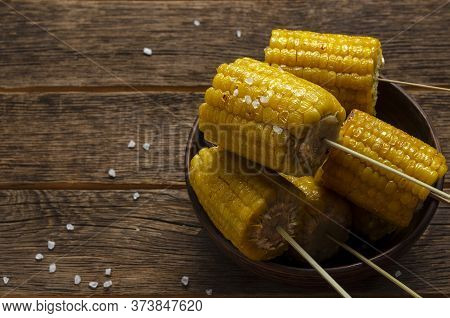 Fresh Roasted Or Grilled Corncobs On The Wooden Background