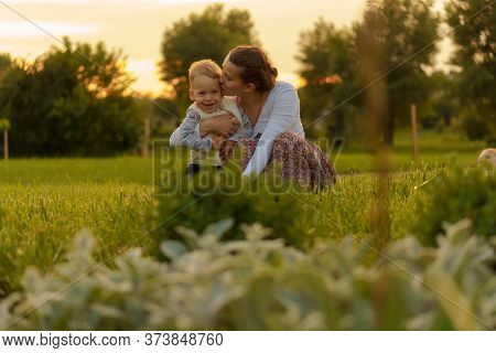 Motherhood, Care, Infants, Summer, Parenting Concept - Young Beautiful Mom With Son Aged Two Years O