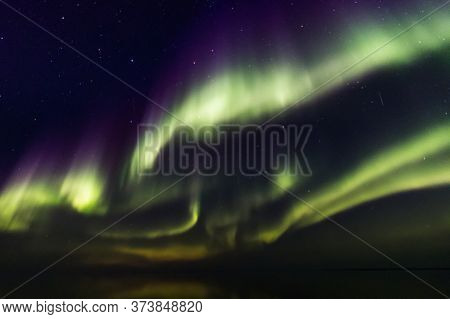 Northern Boreal Lights At Sea In Lady Richardson Bay, Victoria Island, Northwest Passage In Canada.