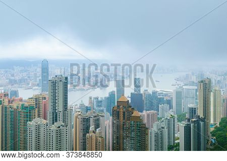 Monsoon Fog Descending On Hong Kong Central District, With High Rise Business And Residential Buidli