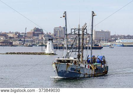 New Bedford, Massachusetts, Usa - March 28, 2018: Weathered Trawler Boomer Too, Hailing Port Boston,