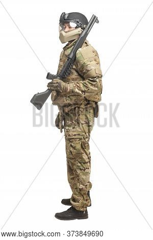 American Commando In Uniform With A Shotgun On A White Background, Portrait Of A Soldier With A Weap