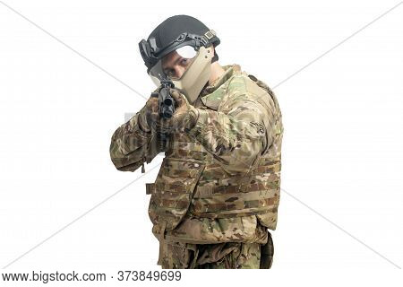Soldier In Military Equipment With A Shotgun To Aim And Attack On A White Background, A Special Forc