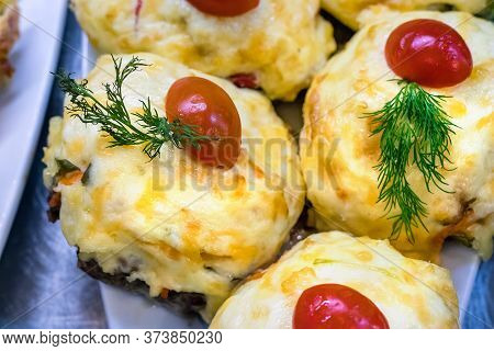 Roasted Mashed Potato With A Cherry Tomato On Top In A Fast Food Restaurant In Petropavlovsk, Russia