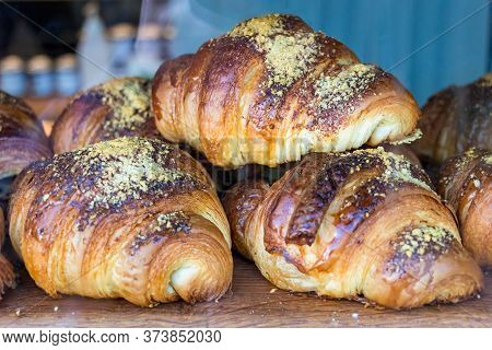 Close-up Of French Croissants Just Baked Placed On The Storefront Of A Bakery Store In Iceland.