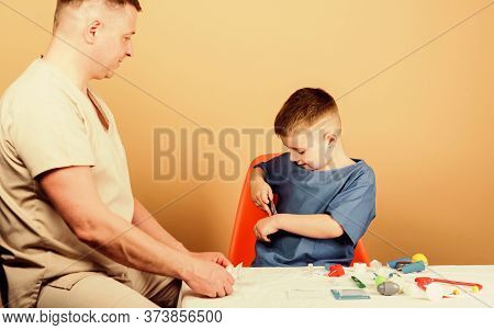 Boy Cute Child And His Father Doctor. Medical Help. Medical Insurance. Medicine Concept. Kid Little
