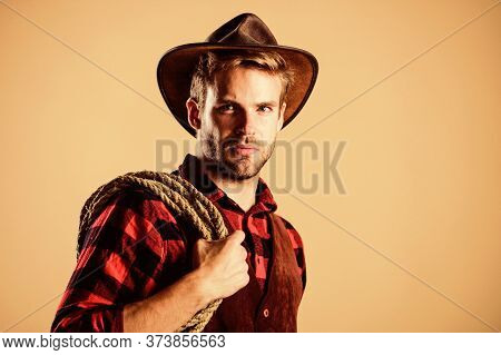 Lasso Is Used In Rodeos Part Competitive Events. Lasso Can Be Tied Or Wrapped. Western Life. Man Cow