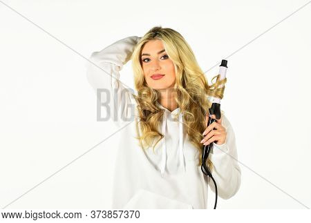 Healthy Long Blond Hair. Beautiful Woman Curling Long Hair Using Curling Iron. Beauty And Fashion. H