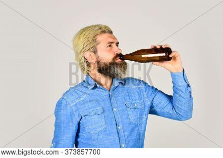 Refreshing Lemonade. Soda Drink. Hipster At Bar. Man Beard And Mustache Hold Bottle. Alcohol Drink.
