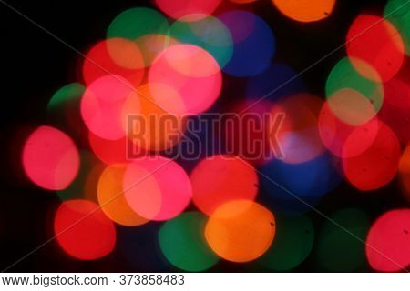 Colored Lights Background. Background of Green, Red, Blue, Yellow, Orange, Pink, Purple colored lights. Colored Christmas Lights for use as backgrounds, wallpaper and art projects.