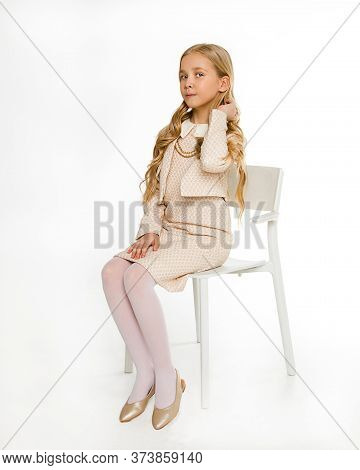 The Perfect Student Is An Excellent Student Sitting On A Chair In A Light Beautiful Dress Uniform. S