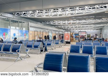 Kharkov, Ukraine- January 31, 2020: People In Modern Waiting Room Of The Airport Waiting For Next Fl