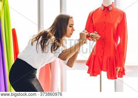 Portrait Of Young Beautiful Pretty Woman Fashion Designer Stylish Working With Mannequins Standing A