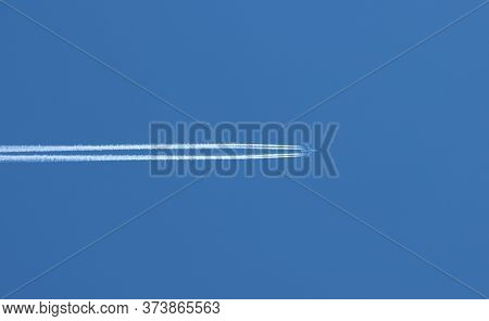 Flight Of A Passenger Plane In The Blue Sky.