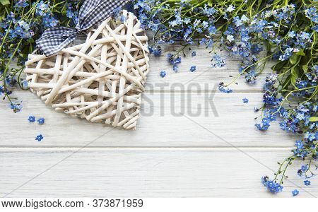 Forget-me-nots And Heart On A Wooden Background, Flat Lay