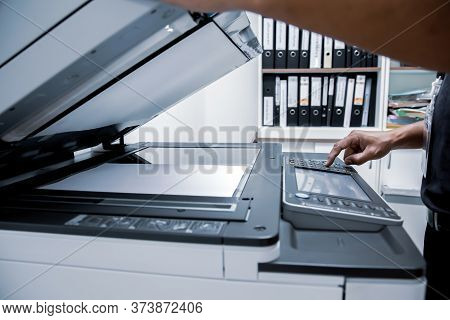 Businessman Press Button Using Photocopier Or Printer Is Office Work Tool Equipment For Scanning Doc