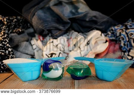 Beautiful Photo Of Washing Powder On The Background Of Dirty Clothes