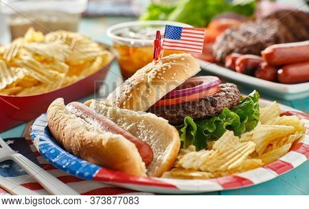 4th of july meal with hamburger and hot dog