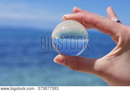 Reflections Of The Clouds And Calm Sea In A Cloudy Day In A Crystal Ball, Environment Concept