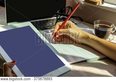 Bangkok, Thailand - Jun 20, 2020 : Hand Of Business Woman Writing On Paper At Her Workstation. Busin