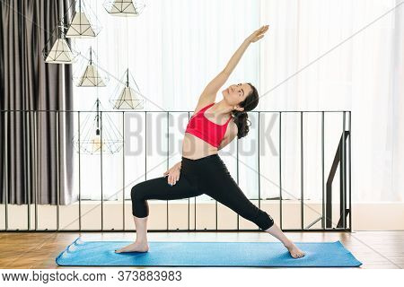 Asian Woman Practicing Yoga From Home When Covid19 Outbreak And Lockdown, Healthy Or Meditation Exer