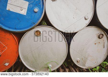 Old Chemical Barrels. Blue And Orange Oil Drum. Steel Oil Tank. Toxic Waste Warehouse. Hazard Chemic