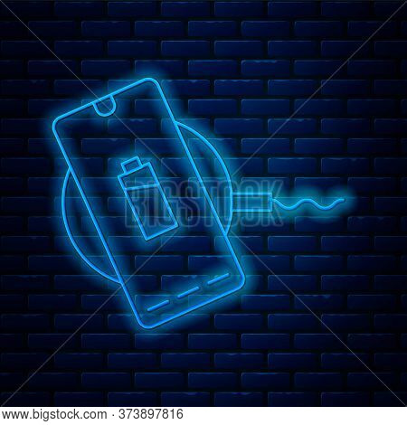 Glowing Neon Line Smartphone Charging On Wireless Charger Icon Isolated On Brick Wall Background. Ch