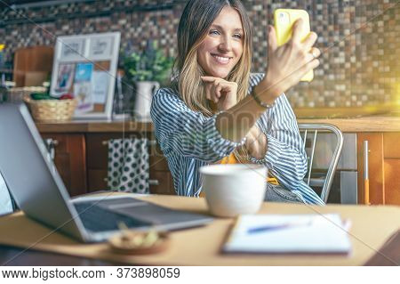 Business Woman Having A Facetime Video Call. Woman Make Selfie. Happy And Smiling Girl Working From