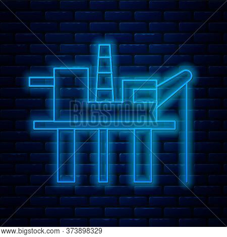Glowing Neon Line Oil Platform In The Sea Icon Isolated On Brick Wall Background. Drilling Rig At Se