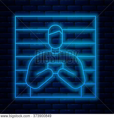 Glowing Neon Line Suspect Criminal Icon Isolated On Brick Wall Background. The Criminal In Prison, S