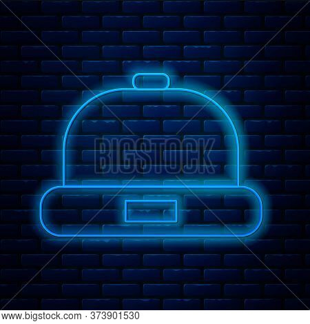 Glowing Neon Line Beanie Hat Icon Isolated On Brick Wall Background. Vector Illustration