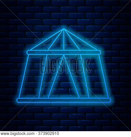 Glowing Neon Line Circus Tent Icon Isolated On Brick Wall Background. Carnival Camping Tent. Amuseme
