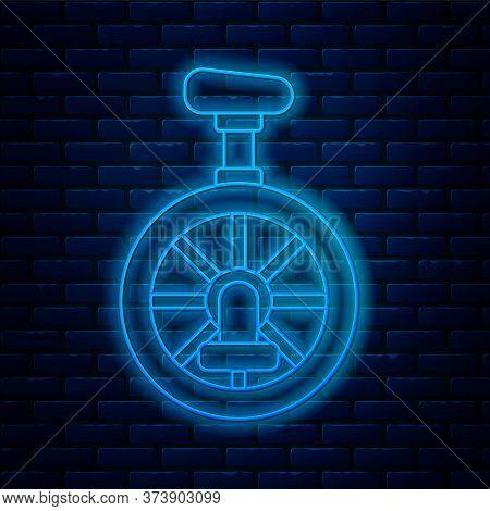 Glowing Neon Line Unicycle Or One Wheel Bicycle Icon Isolated On Brick Wall Background. Monowheel Bi