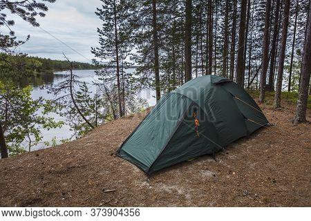 The Camping Tent Near Chirka-kem River In The Summer. Karelia. Russia