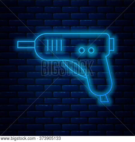 Glowing Neon Line Electric Hot Glue Gun Icon Isolated On Brick Wall Background. Hot Pistol Glue. Hot