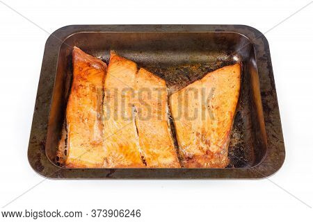Baked Pieces Of The Trout Fillet On The Rustic Metal Oven Tray On A White Background