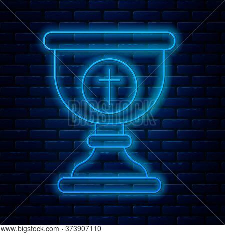 Glowing Neon Line Christian Chalice Icon Isolated On Brick Wall Background. Christianity Icon. Happy