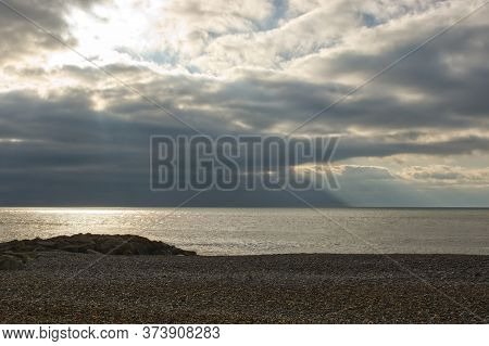 Shingle Beach At Rottingdean, Near Brighton, East Sussex, England. With Stormy Sky