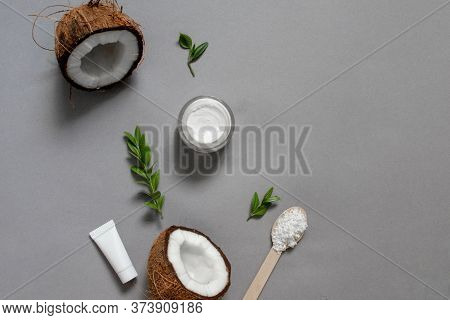 Homemade Coconut Oil Cosmetics For Skin And Hair Care. Oil In Small Bottle, Face Cream, Halves Of Co