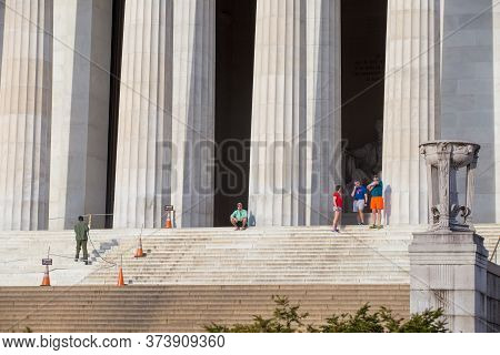 Spring, 2016 - Washington Dc, Usa - People Stand At The Columns Of The Lincoln Memorial In Washingto